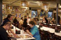 Rustic Inn Customers Choosing Menu